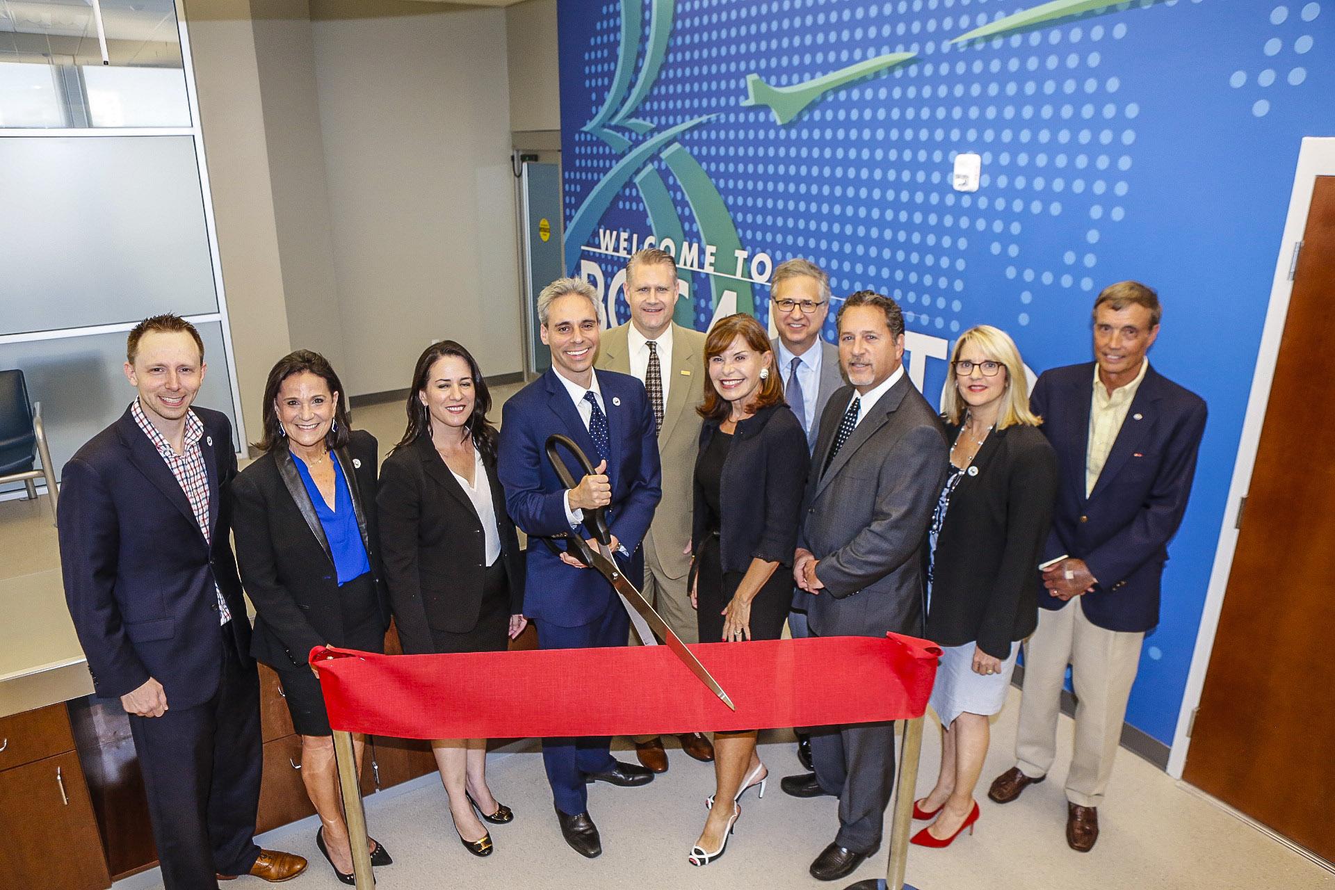 Mayor Scott Singer cuts ribbon at grand opening ceremonies at BRAA U.S Customs & Border Protection Service office