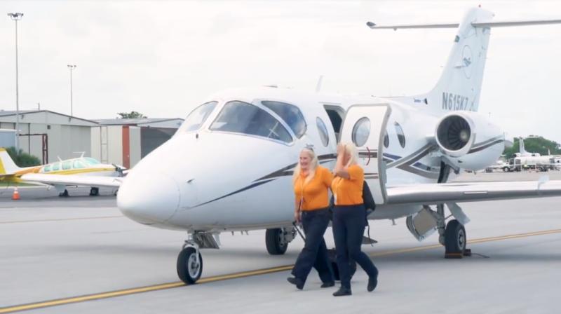 Female pilot crew leave private jet