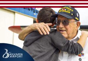 Boy and Veteran hug