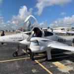 Lynn University students preflight Diamond Twin Star aircraft