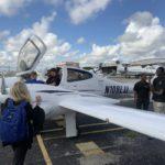 Students gather around the Lynn University Diamond DA-42 Twin Star multi-engine airplane.